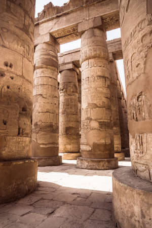 hieroglyphics: A sandstone column in Egypt.  columns covered in hieroglyphics Stock Photo
