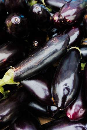 aubergine: Fresh juicy aubergine.  eggplants at market