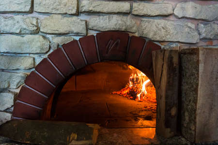 wood burner: fire in the oven.  Traditional Pizza oven