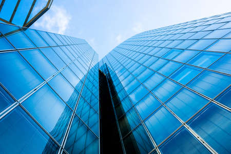 Blue skyscraper facade. office buildings. modern glass silhouettes of skyscrapers