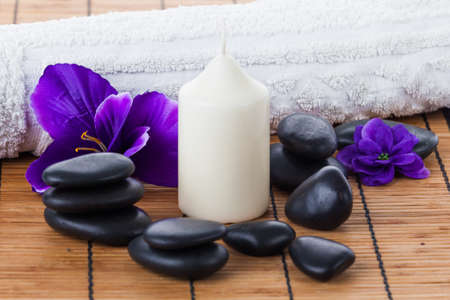 aroma facial: Spa concept: zen stones, candles and flowers