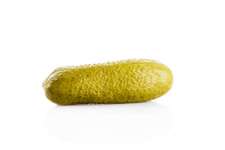 marinated gherkins: marinated pickled cucumbers isolated on white.  Pickled green gherkins