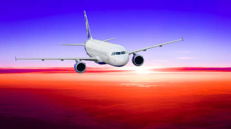 km: sunset with a height of 10 000 km. Dramatic sunset.  Airplane in the sky Stock Photo