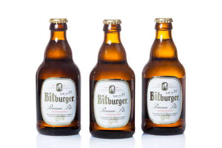 founded: DUSSELDORF, GERMANY - APRIL 08, 2016: A bottle of Bitburger Beer isolated on white. Bitburger brewery is a large German brewery founded in 1817 by Johann Wallenborn