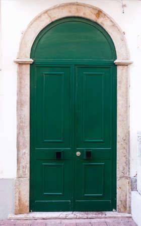 green door: Green door. entrance door in front of residential house.