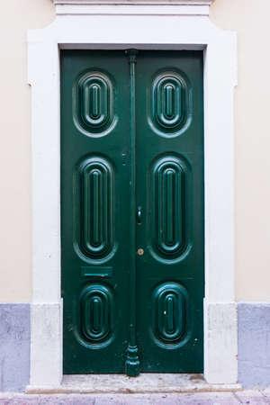 front house: Green door. entrance door in front of residential house.
