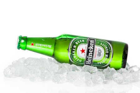 DUSSELDORF, GERMANY - APRIL 08, 2016:  Bottle of Heineken Lager Beer on white background. Heineken Lager Beer is a pale lager beer produced by the Dutch brewing company Heineken International