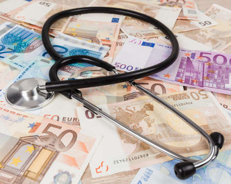 euro banknotes and stethoscope. Health care cost. medical concept 版權商用圖片