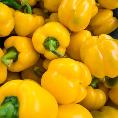 Background of Yellow Pepper. Heap Of Ripe Big Yellow Peppers Stock Photo