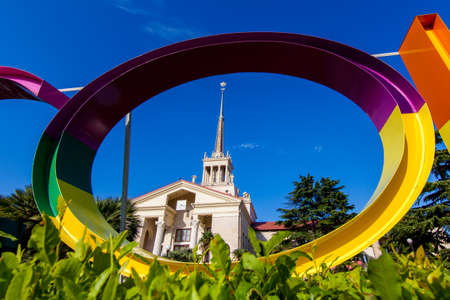 Commercial Sea Port of Sochi and beautiful tropical garden with palm trees.  Port cityscape square