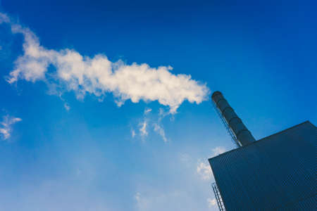 Smoke from smokestack.  Smoke atmosphere emission. Dirty smoke on the sky, ecology problems