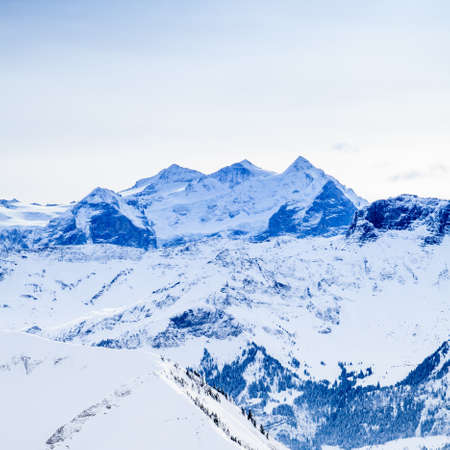 Winter snow covered mountain peaks in Europe. The Alps winter mountain landscape Stock Photo