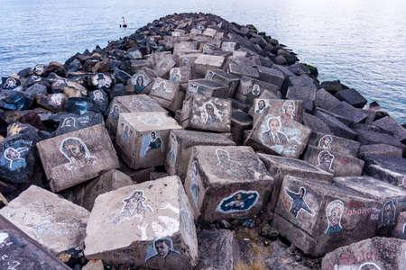 SANTA CRUZ DE TENERIFE, SPAIN - JANUARY 25: Graffiti on a stones of a breakwater on January 25, 2017 in Santa Cruz de Tenerife, Spain Editorial