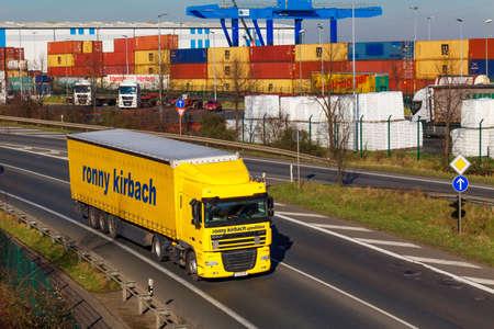 DUSSELDORF ,GERMANY - FEBRUAR 16: transport truck on the highway on Februar 16,2016 in Dusseldorf, Germany. truck on asphalt road