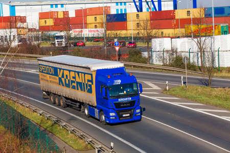 DUSSELDORF ,GERMANY - FEBRUAR 16: transport truck on the highway on Februar 16,2016 in Dusseldorf, Germany.  industrial infrastructure and railroad, cargo transportation