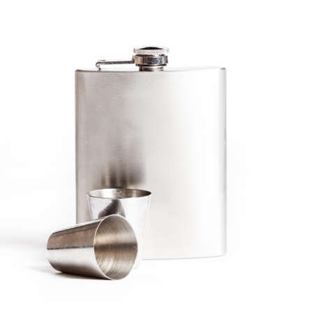 Hip flask and cups  isolated on white Stock Photo