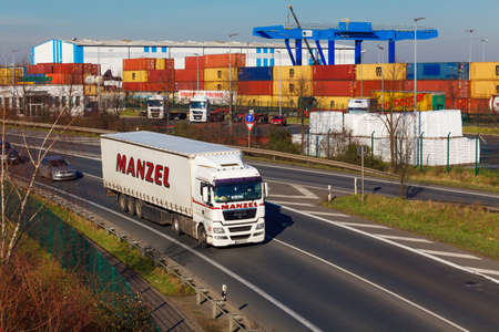 lading: DUSSELDORF ,GERMANY - FEBRUAR 16: transport truck on the highway on Februar 16,2016 in Dusseldorf, Germany.  industrial infrastructure and railroad, cargo transportation