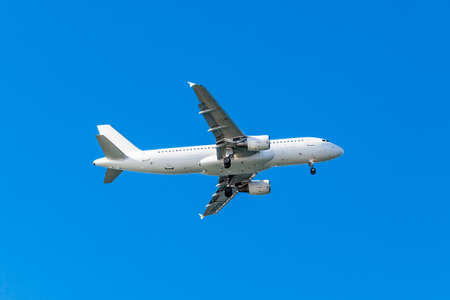 white airplane on a blue background. airplane in the sky