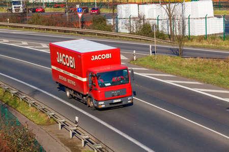 truck driver: DUSSELDORF ,GERMANY - FEBRUAR 16: transport truck on the highway on Februar 16,2016 in Dusseldorf, Germany. truck on asphalt road