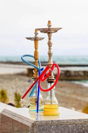 traditional arabic shisha pipes hookah or Water pipe. Sea View Restaurant