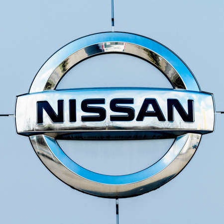GERMANY, MOENCHENGLADBACH -APRIL 16, 2017: Logotype of Nissan corporation. Nissan company logo on dealership building Editorial