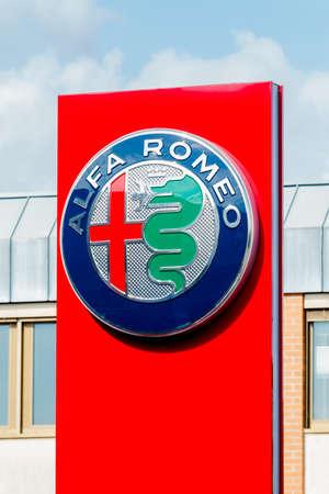 GERMANY, MOENCHENGLADBACH -APRIL 16, 2017: Logotype of Alfa Romeo corporation. Alfa Romeo company logo on dealership building