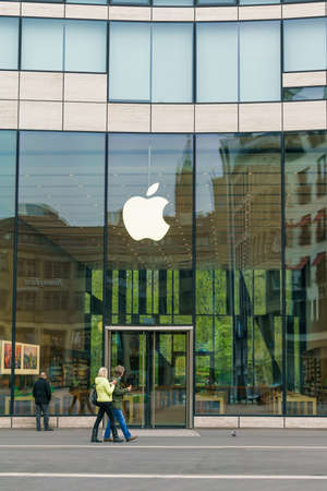 headquartered: DUSSELDORF, GERMANY - APRIL  14, 2017: Apple store in Dusseldorf. Apple is an American multinational technology company headquartered in Cupertino, California