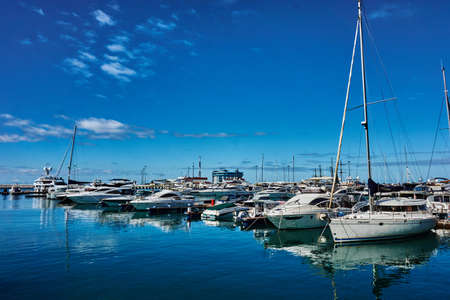 complex navigation: Sailing yachts and private boats at pier in Sochi seaport. yachts in the Bay at the seaport in Sochi city center. RUSSIA