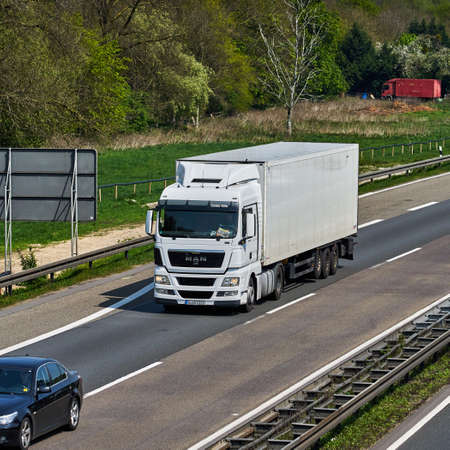 storage box: DUSSELDORF ,GERMANY - APRIL 20: transport truck on the highway on April 20,2017 in Dusseldorf, Germany. truck on asphalt road