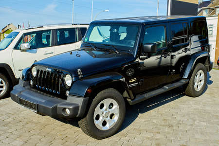 MOENCHENGLADBACH, GERMANY - APRIL 30, 2017: Beautiful JEEP Car parking in front of car store
