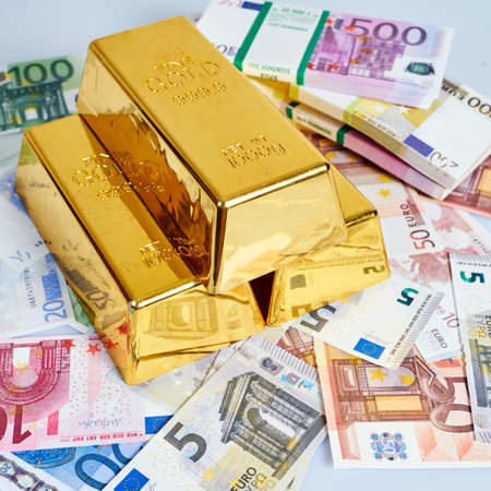 kilo: Finance background with money and gold. Finance concept Stock Photo