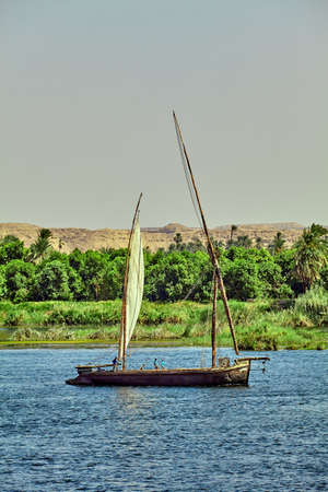 river banks: Traditional Boat on the Nile River in  Egypt Stock Photo