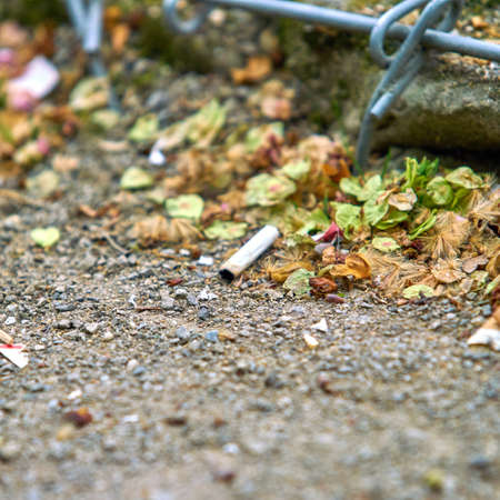 cigarette butts. Smoking is harmful to health.