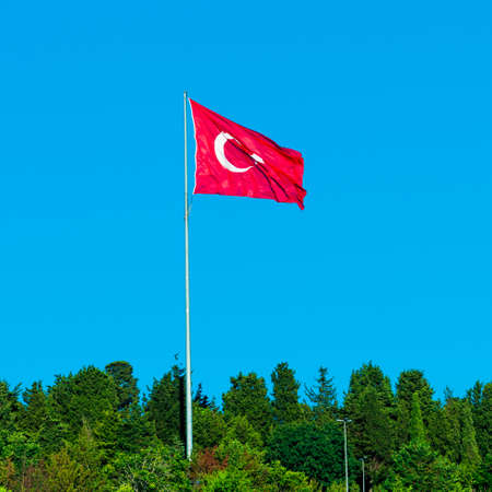 flag of Turkey on blue sky. Turkish flag Stock Photo