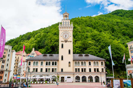 Sochi, Russia - Juny 21, 2017: Rosa Khutor Clock tower and infrastructure of Alpine ski resort