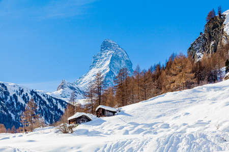 Scenic view on snowy Matterhorn peak in sunny day with blue sky.  Switzerland Stock Photo