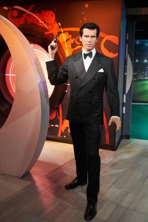 pierce: Amsterdam, Netherlands - September 05, 2017: Wax figure of Pierce Brosnan as James Bond 007 agent in Madame Tussauds Wax museum in Amsterdam