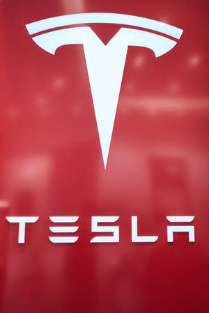 Dusseldorf, Germany - September 09, 2017: Tesla Logo sign  at  Tesla Motors store in Dusseldorf, Germany