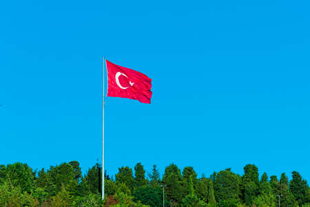 flag of Turkey on blue sky. Turkish flag Фото со стока