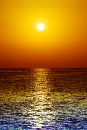 sunset over ocean. Sunset on the beach with beautiful sky. Dramatic sunset