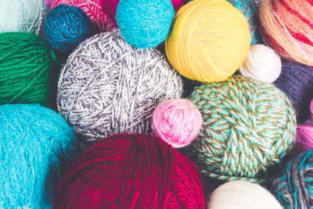 Colored balls of yarn. Colorful background with yarn ball 스톡 콘텐츠