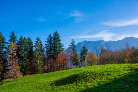 landscape in the Alps with fresh green meadows. Swiss Alps