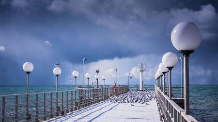 pier in winter. Snow covered pier. Winter landscape. Russia
