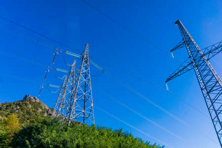 High voltage post. High power electricity poles Stock Photo