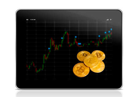 virtual money Bitcoin cryptocurrency. tablet with business chart and golden bitcoin