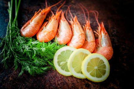 shrimps for dinner on stone plate. Food background