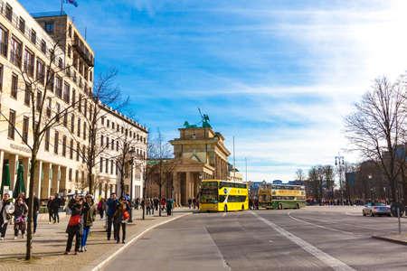 BERLIN, GERMANY - MARCH 22, 2015: tourist double decker bus near Brandenburg gate in Berlin on March 22, 2015