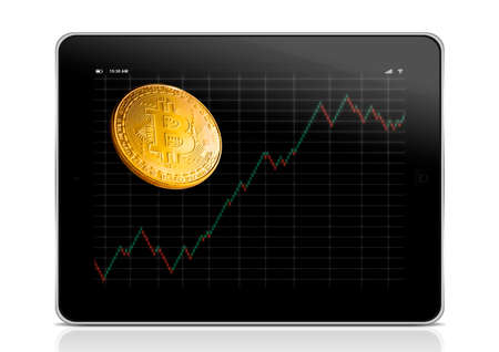 tablet with business chart and golden bitcoins