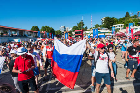 SOCHI, RUSSIA - JUNE 14, 2018: Football fans on the square. In Sochi, during the FIFA World Cup 2018