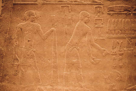 Egyptian Hieroglyphic carvings on the exterior walls of an ancient temple